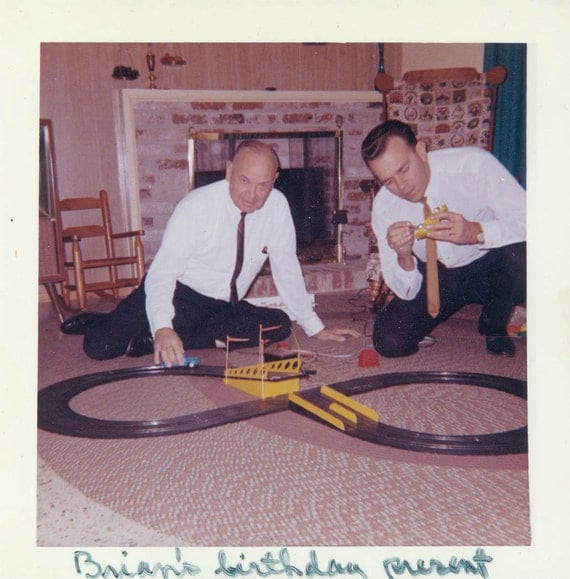 vintage photo 1960s Kodacolor Men Play with Indy Race Car toy on Floor