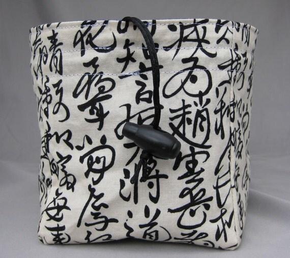 large kanji on cream and metallic gold swirls on blue square bottom dice bag