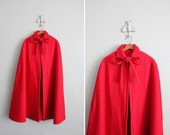 RESERVED - 1960s vintage red wool cape
