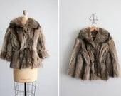 1970s vintage raccoon fur tie coat