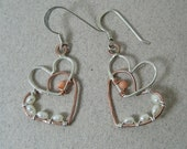 Hammered overlapping beaded sterling silver and copper heart dangles