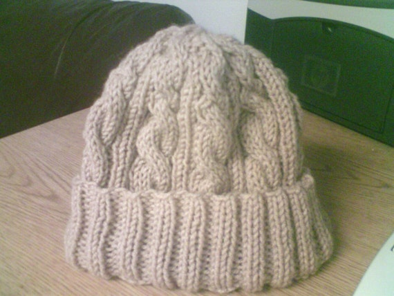 Knitting Pattern For Flat Hat : Flat-Knit Cabled Hat Pattern