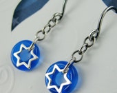 girl with a STAR of DAVID earrings in sterling silver with blue czech glass circles