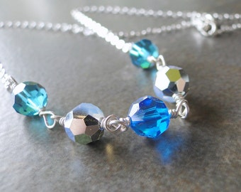 Blue And Silver Multi Facted Crystals Wire Wrapped To A Sterling Silver Chain