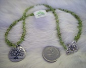Tree of life necklace with green peridot chips, silver plated