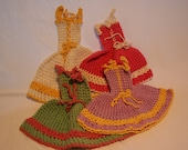 4 dress style potholders or doilies