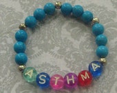 Handmade Turquoise colored ASTHMA Health Awareness Stretchy Bracelet for kids
