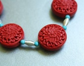 Carved Cinnabar and Turquoise Howlite Necklace