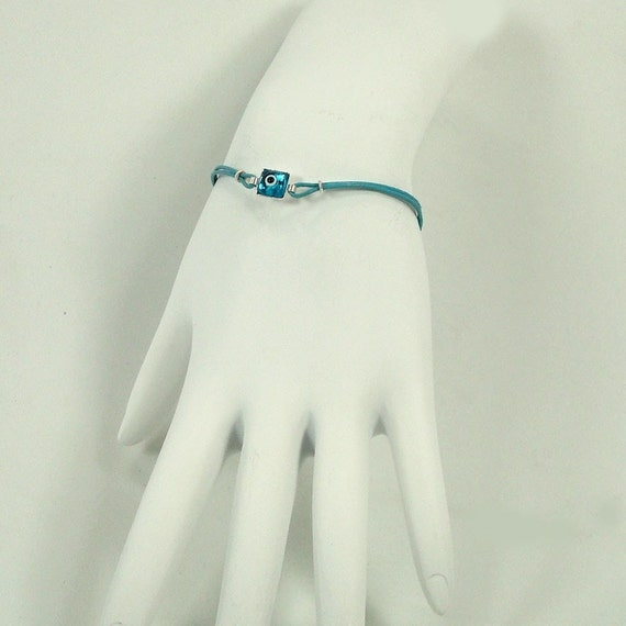 Lucky Evil Eye Bracelet with Sterling Silver  and  Aqua Colored Leather Cord