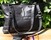 Brown leather bag with zipper closure. Recycled leather.