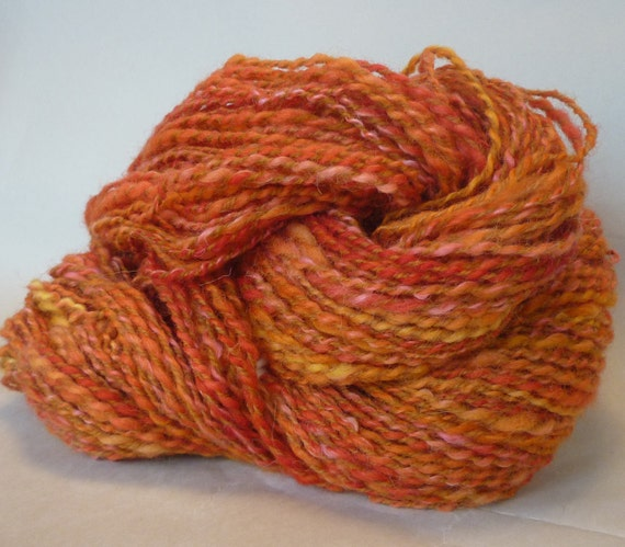 Hand spun, hand dyed wool-alpaca blend yarn in blend of oranges and golds