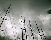 Masts: dramatic black and white fine art photograph print of a row of sailboat masts and lines against gray, cloudy sky - UninventedColors