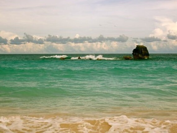 Horseshoe Bay: a fine art photograph of Bermuda seascape with sand, turquoise ocean water, cloudy sky, and large rock