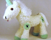 Macaroon the Unicorn, a white Mohair Unicorn with Mint Hooves and Horn.