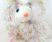Up for adoption is Sprinkles a Bubble Gumball Babee original from Cotton Candees. Sprinkles is sew soft and furry with many places for little hands to grasp.  Great as a baby gift for either a boy or girl.