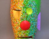 bright mask that must be symbolic or totemic or both