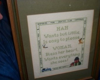 framed cross stitch picture ,man wants but little, is easy to please, Woman wants everything she sees.