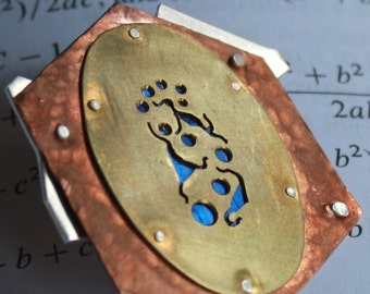 Quixotic Brooch in Copper, Brass, Sterling Silver and Solar Panel Glass
