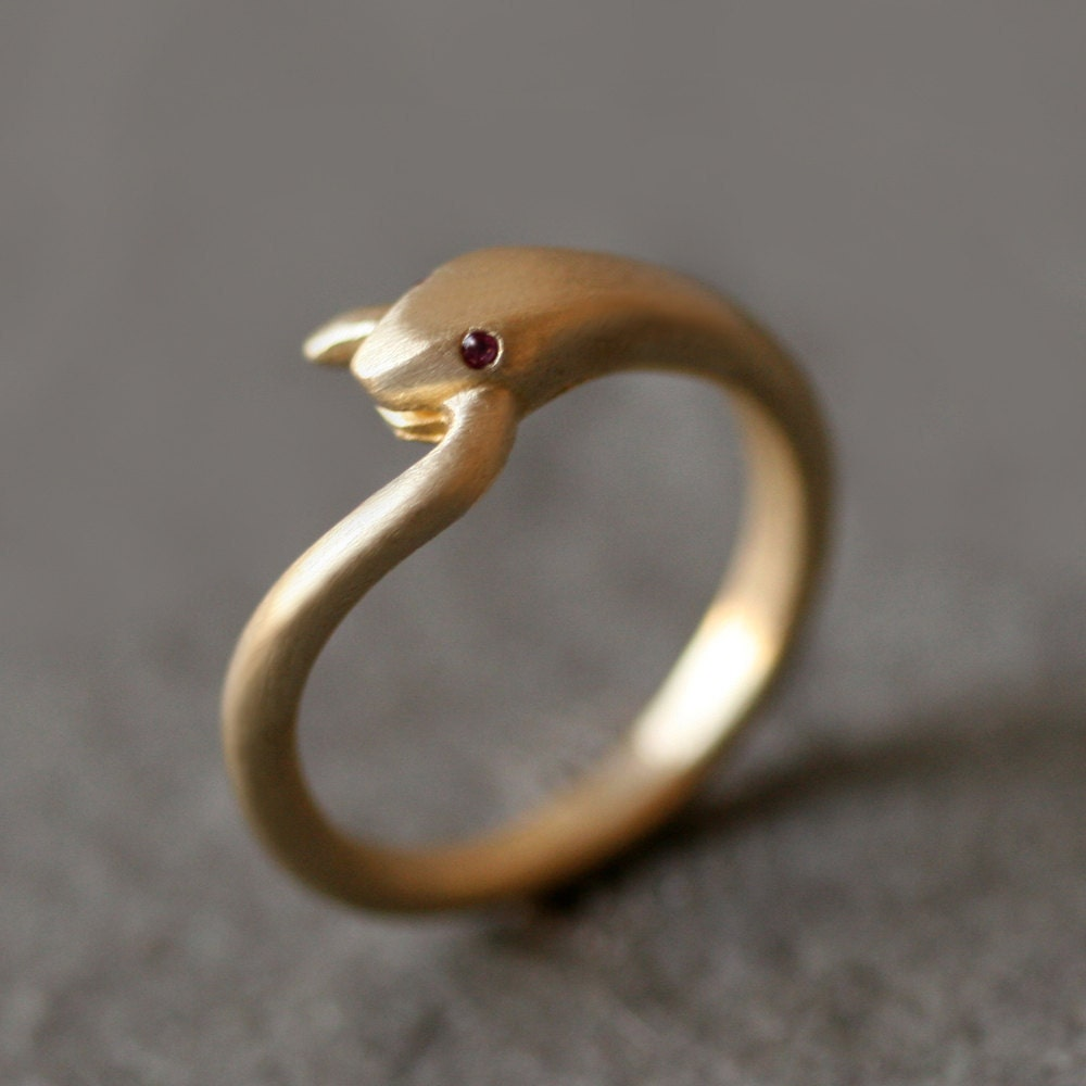 Snake tail ring in brass with gemstone eyes The designlover