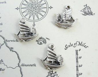 Three little ship charms