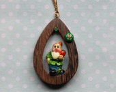 Green magic gnome with strawberry necklace