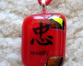 "Chinese ""Loyalty"" pendant on a silk necklace"