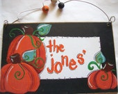 Adorable pumpkins hand personalized sign for halloween and fall and autumn