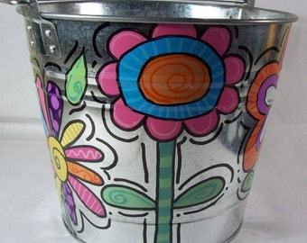 Hand painted personalized galvanized bucket with funky bright flowers perfect for any room