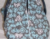 Carseat canopy cover made with Michael Miller Bicycles complimented with a blue minky dimple dot fabric for warmth
