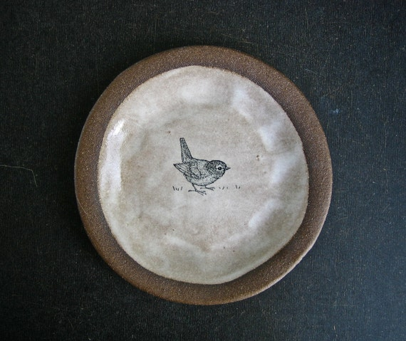 brown plate with BIRD.