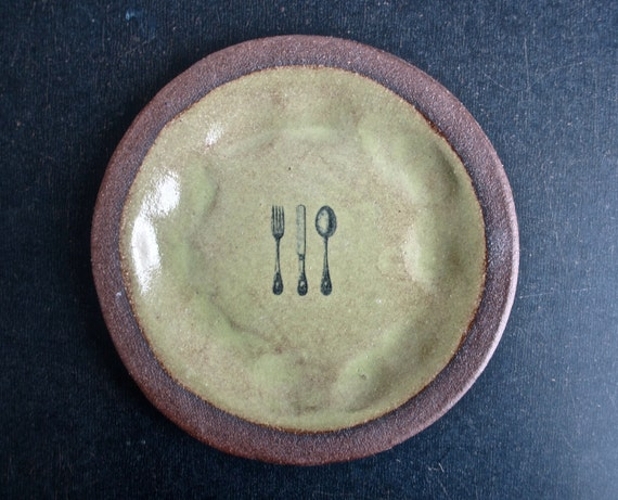brown and green plate with CUTLERY.