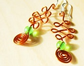 Celtic knotwork copper wire earrings with grass green amethyst beads and sterling ear-wires