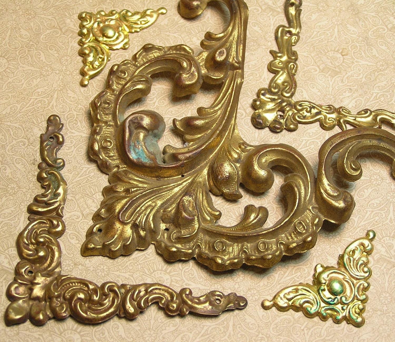 vintage thin metal frame corners stampings