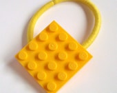 Pony Tail holder made with Lego (r) plate Bright Yellow