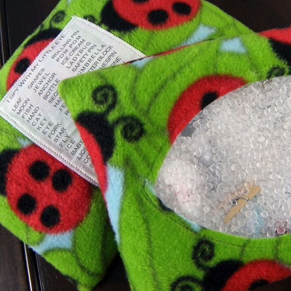 Red Ladybug I Spy Bag - supersized bright green soft game with 45 trinkets hidden inside