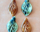 4 Handmade ceramic beads - Pinch top Leaf beads