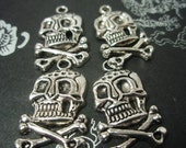 skull and crossbone charm or pendant x 4 on SALE