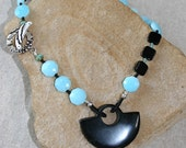 Black Beauty with faceted Peruvian Opals