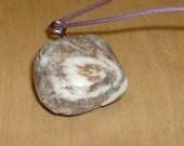 Polished beach pebble pendant