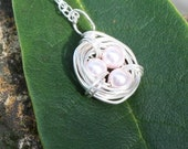 Bird's Nest Necklace. Pink Eggs are Swarovski Pearls, Nest is Sterling Silver, Chain is Recycled Sterling Silver, All Vegan From Daisy Wares