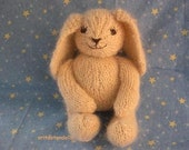 Hand knitted bunny of natural materials