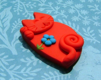Red Sleeping cat with blue flower pin or magnet