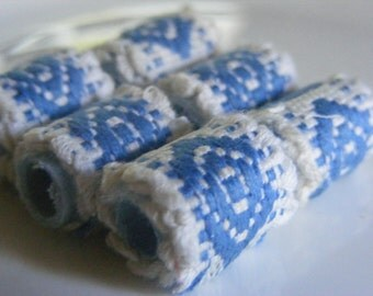 Textile Bead Yes, we know we're Norwegian blue but what are we supposed to DO. Does this change the job description.