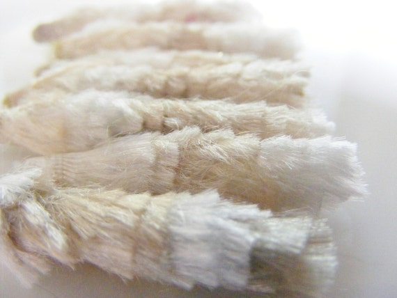 Textile Art Bead Ecru, white and a dark tan are perfectly elegant for a winter fashion palette.  Add feathers and we're divine.