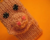 iPIG. The hand-knit 4th Gen iPod Nano case with pocket for earphones.