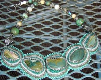 Mermaid Lagoon, a Handmade Bead Embroidered Necklace in Ocean Colors with Designer Pewter Mermaid Beads
