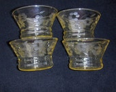 Four yellow depression glass dessert dishes