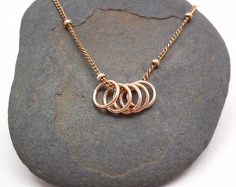 5 Golden rings necklace