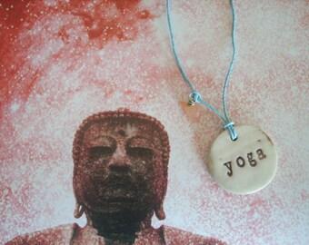 Earth Friendly YOGA Porcelain Necklace with a Carnelian Bead on Blue Hemp