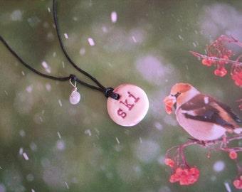 Earth Friendly SKI Porcelain Necklace with a Rock Crystal Bead on Black Hemp